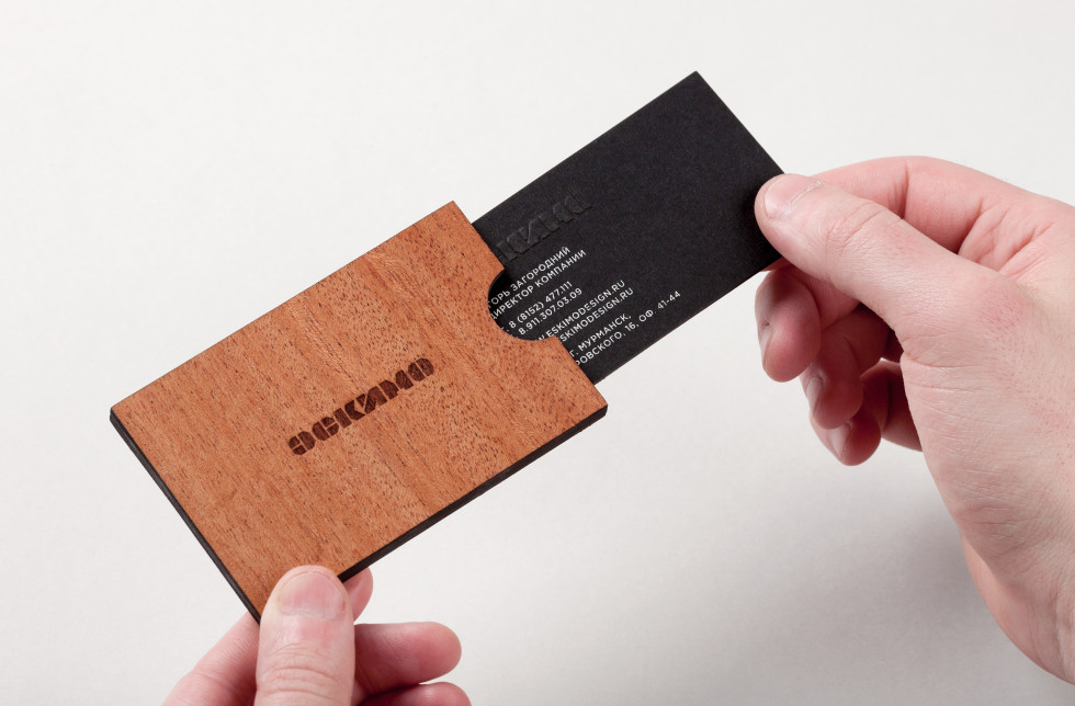 Cool business card with a card holder eskimo for Creative business card holders